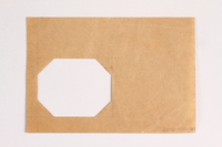 2010.441.105 back Sheet of paper with an octagonal cutout used by a Dutch resistance member who forged identity cards  Click to enlarge