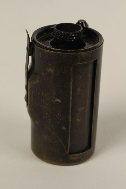 1991.103.1 front Film canister for a Leica camera that was used in Krakow