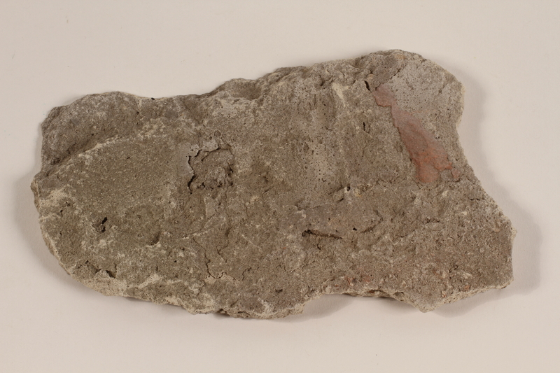 1991.103.2 front Wall fragment from a gas chamber at Auschwitz concentration camp