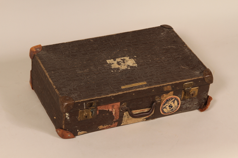 2007.517.1 front Brown alligator leather suitcase used by Austrian Jewish child on the Kindertransport