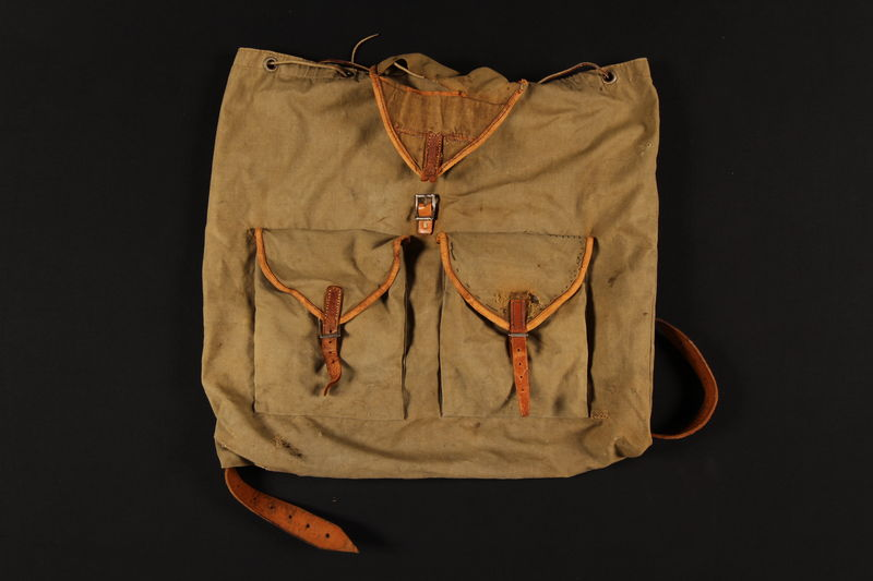 2007.517.2 front Monogrammed green knapsack used by an Austrian Jewish child on the Kindertransport