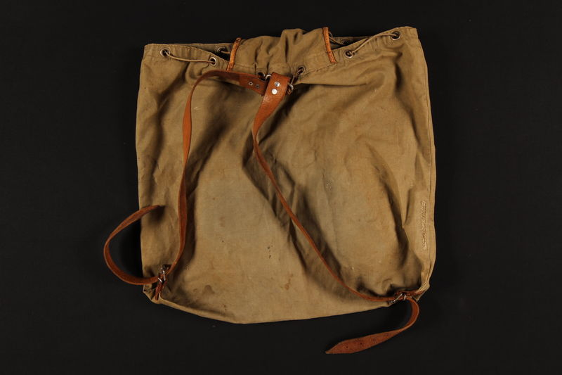 2007.517.2 back Monogrammed green knapsack used by an Austrian Jewish child on the Kindertransport