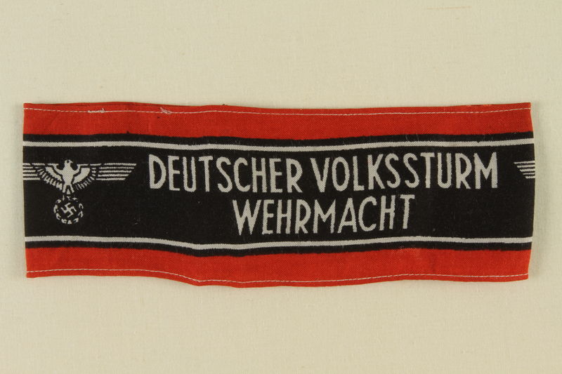 2010.456.3 front Deutscher Volkssturm Wehrmacht armband with an Imperial eagle taken by a US soldier