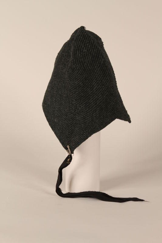 1991.111.1 side Cap worn by a young girl in a concentration camp