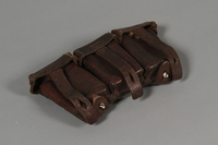 2010.443.36 front Belt attachment with a set of 3 brown leather K98k ammunition pouches used during WWII in eastern Poland  Click to enlarge