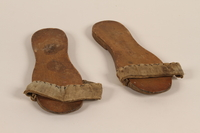 2010.464.2_a-b front Wooden sandals with a canvas strap worn by a Mir Yeshiva refugee in Shanghai  Click to enlarge