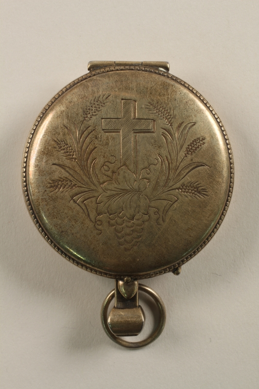 2010.463.2 closed Sterling silver communion host pyx engraved with a cross, wheat, and a grape cluster used by a US Army chaplain