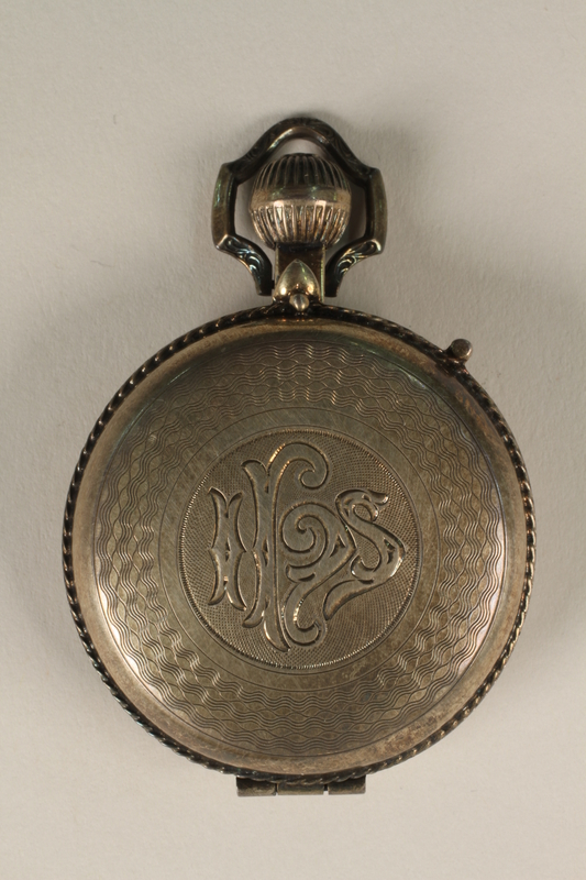 2010.463.3 closed Sterling silver communion host pyx with the engraved monogram IHS used by a US Army chaplain