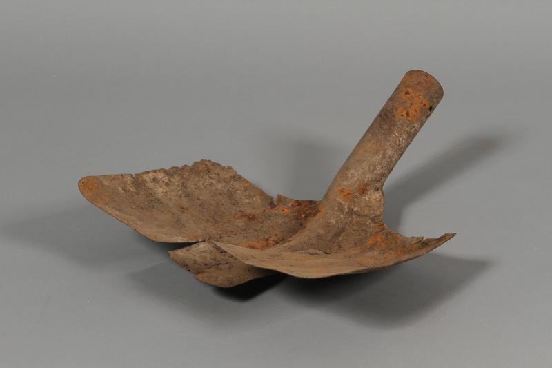 2010.443.41 front Wide rectangular shovel head recovered postwar at a mass execution site