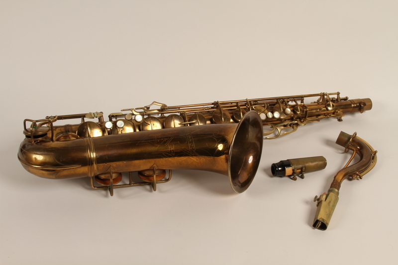 2010.472.3_a1-3 front Saxophone, case and accessories used by a Polish Jewish musician in a band that toured DP camps