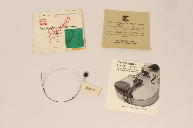 2010.472.2 m open Violin, bows, case and accessories recovered from Łódź ghetto and played in DP camps by a Polish Jewish musician