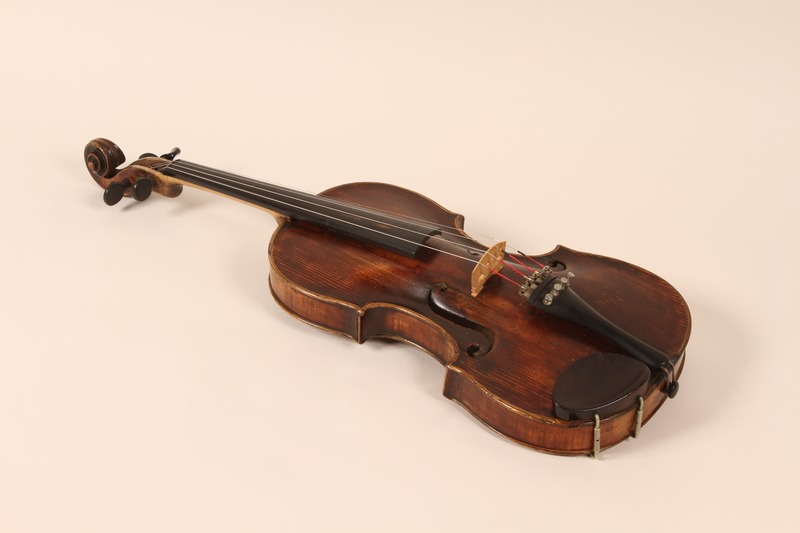 2010.472.1_a front Violin, bows, case and accessories recovered from Łódź ghetto and played in DP camps by a Polish Jewish musician