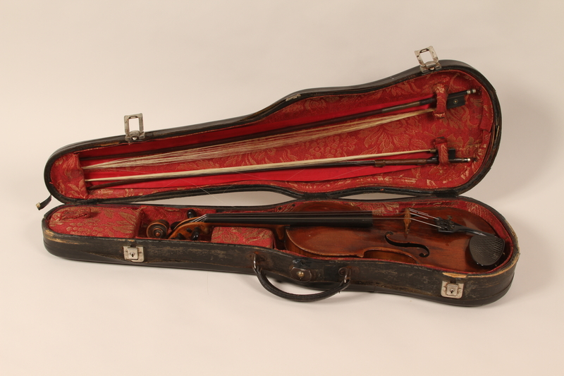 2010.472.1_a-d front Violin, bows, case and accessories recovered from Łódź ghetto and played in DP camps by a Polish Jewish musician
