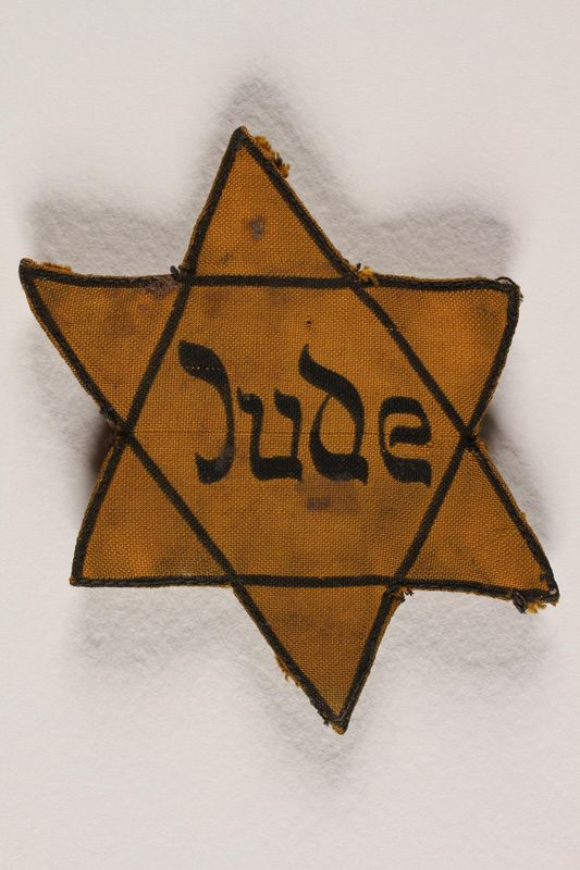 1991.117.2 front Star of David badge with Jude printed in the center