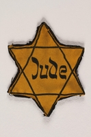 2010.475.2 front Star of David badge printed with Jude worn by a German Jew  Click to enlarge