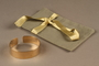 Adjustable cuff bracelet made from gold marks with pouch owned by German Jewish refugee