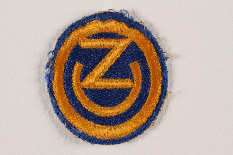 2011.75.3 front US Army 102nd Infantry Division shoulder sleeve patch with OZ worn by a soldier