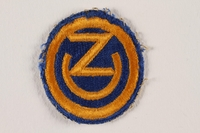 2011.75.3 front US Army 102nd Infantry Division shoulder sleeve patch with OZ worn by a soldier  Click to enlarge
