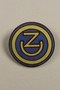 US Army 102nd Infantry Division enameled lapel pin with OZ worn by a soldier