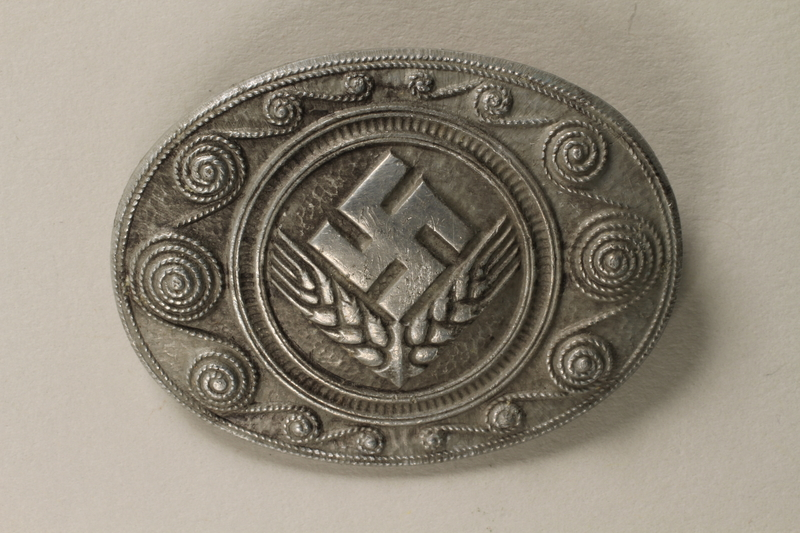 2011.75.7 front Women's Reich Labor Service commemorative pin acquired by a US soldier