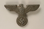 Pressed tin cap badge of a Reichsadler acquired by a US soldier