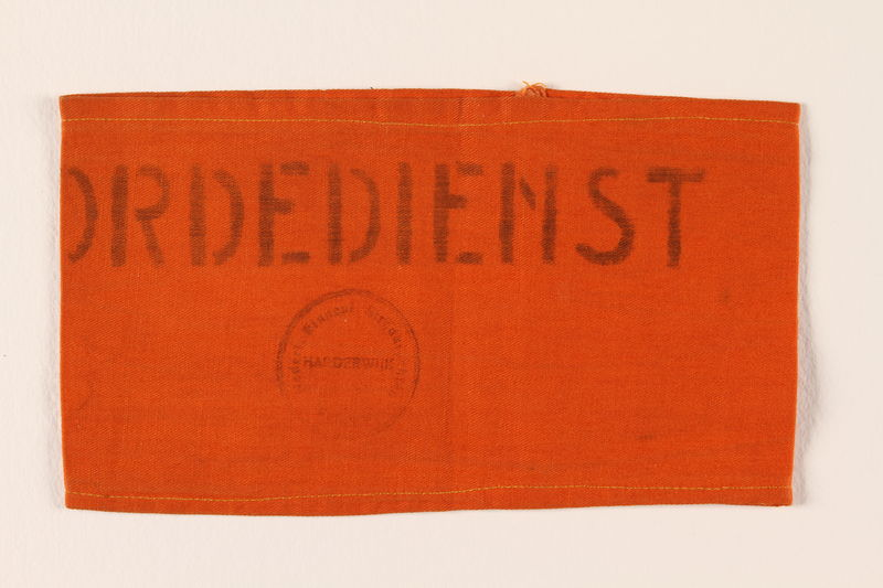 2010.488.3  front Ordedienst orange armband worn by a Dutch rescuer after the war