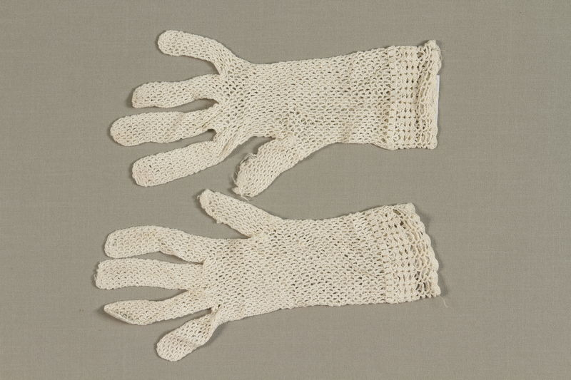 2010.488.4_a-b front Pair of white lace gloves crocheted by a Dutch Jewish woman while living in hiding