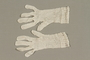 Pair of white lace gloves crocheted by a Dutch Jewish woman while living in hiding
