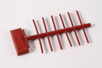 2010.488.5 front Red wooden tie rack made by a Dutch Jew while living in hiding  Click to enlarge