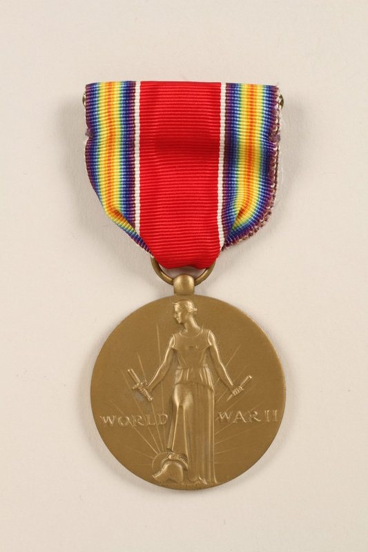 2011.75.11_a front World War II Victory Medal with ribbon and box awarded to a US soldier