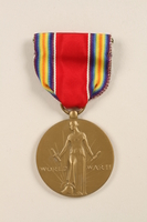 2011.75.11_a front World War II Victory Medal with ribbon and box awarded to a US soldier  Click to enlarge