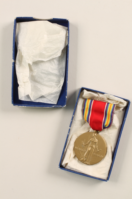 2011.75.11_a-b open World War II Victory Medal with ribbon and box awarded to a US soldier