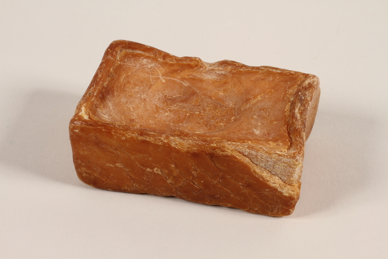 1991.123.2 back Soap acquired by a prisoner in Buna concentration camp
