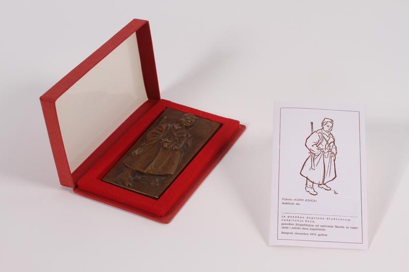 2011.108.2 a-c front Kurir Jovica plaque, box, and card awarded to a Macedonian Jewish partisan woman