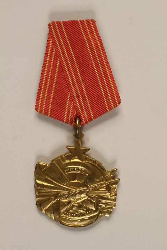 2011.108.4_a front Yugoslav Orden za Hrabrost medal, ribbon, box, and certificate awarded to a Macedonian Jewish partisan woman