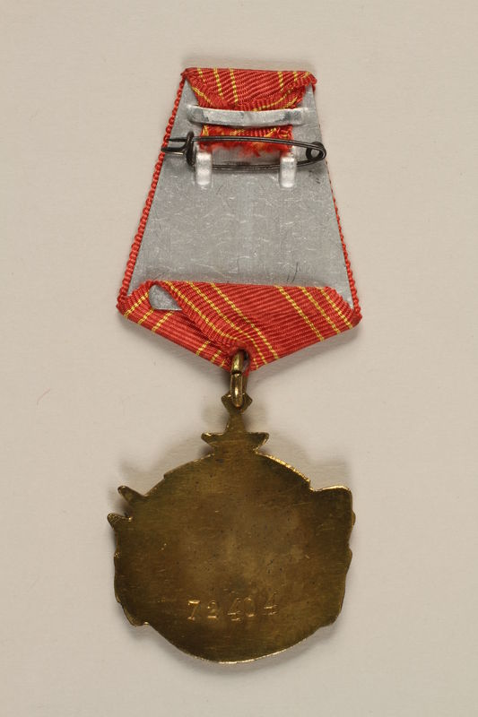 2011.108.4_a back Yugoslav Orden za Hrabrost medal, ribbon, box, and certificate awarded to a Macedonian Jewish partisan woman