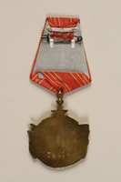 2011.108.4_a back Yugoslav Orden za Hrabrost medal, ribbon, box, and certificate awarded to a Macedonian Jewish partisan woman  Click to enlarge