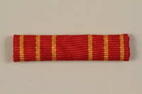 2011.108.4_d front Yugoslav Orden za Hrabrost medal, ribbon, box, and certificate awarded to a Macedonian Jewish partisan woman  Click to enlarge