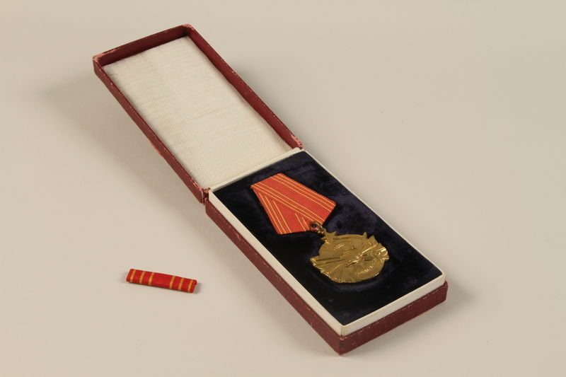 2011.108.4_a_b_d open Yugoslav Orden za Hrabrost medal, ribbon, box, and certificate awarded to a Macedonian Jewish partisan woman