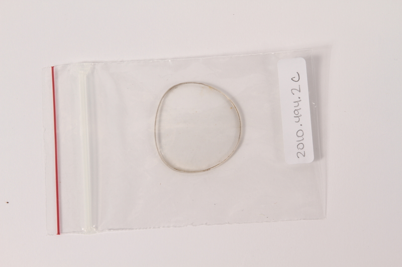 2010.494.2 c front Plastic eyeglass frames, temple and lenses worn by a Jewish concentration camp inmate