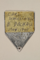 2010.494.3 back Metal ID badge with number 87308 issued to a Jewish prisoner  Click to enlarge