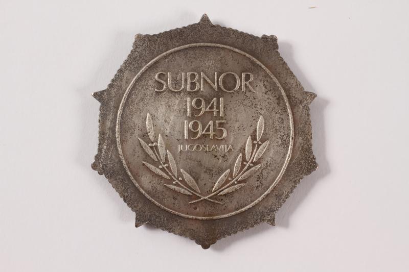 2011.108.19 a back SUBNOR medallion awarded to a Macedonian Jewish partisan woman