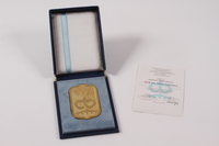 2011.108.22 a-c front Medallion, box and card from Cyril and Methodius University of Medicine awarded to a Macedonian Jewish man  Click to enlarge