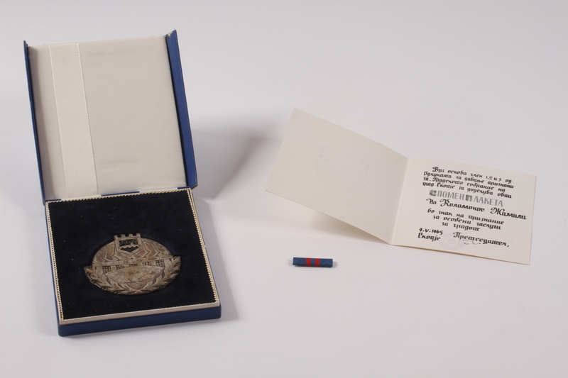 2011.108.23 a-d front Medallion, box, pamphlet, and bar pin awarded to a Macedonian Jewish partisan woman