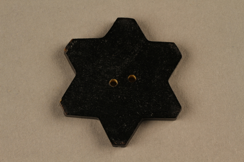 1991.135.1 back Star of David button used to identify a Bulgarian Jew
