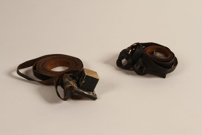 2004.611.2 a-b front Set of tefillin owned by a Hungarian Jewish concentration camp survivor
