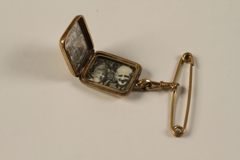 2006.19.61 open Rectangular locket with 3 photos owned by a German Jewish businessman in Shanghai