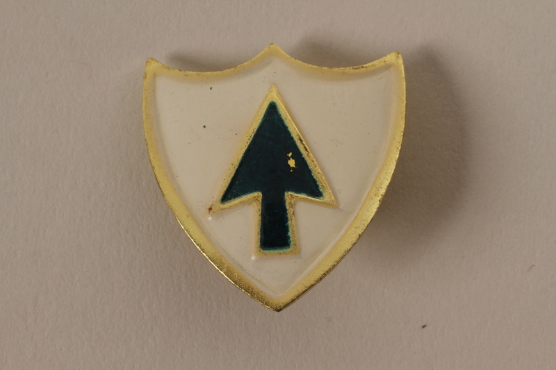2011.75.15_b front Set of US Army 26th Infantry Regiment lapel pins acquired by US soldier
