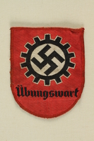 1991.139.4 front Nazi patch with a swastika  in a cogwheel acquired by a US soldier  Click to enlarge