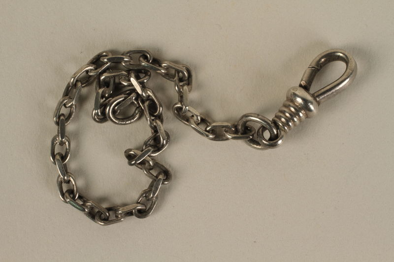 2005.602.5 front Silver metal cable link chain used to hold sports medals awarded to a German Jewish deaf-mute athlete